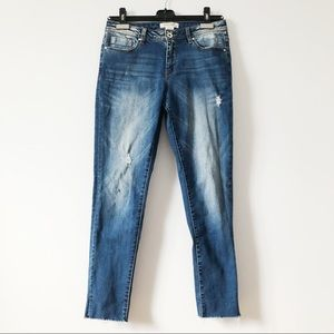 3/20$ Eighty two cropped skinny blue jeans